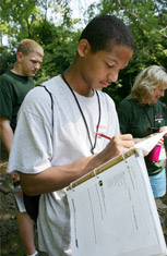 Steven Hardin from Huntington Middle School records observations of Onondaga Creek in his field notebook.