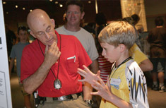 Future scientist Andy White, a graduate of Edward Smith School, discusses the environmental processes he learned during Summer Science Week with SUNY-ESF Distinguished Teaching Professor Peter Black.