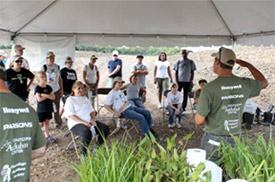 Volunteers listen as Jeremy Neumann, senior scientist at Parsons, explains the importance of plants in providing a diverse habitat.