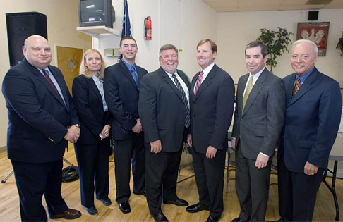 Pictured here from left to right: Home HeadQuarters Executive Director Kerry Quaglia; SNI Director of Development Linda Henley; Park Avenue Neighborhood Association President Jeff Romano; Honeywell Director of Remediation Dave Wickersham; Syracuse Mayor Matthew Driscoll; Congressman James Walsh; and Onondaga County Executive Nicholas Pirro.