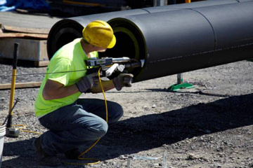 VARI-TECH employee welds the double-walled pipe. VARI-TECH, based in Liverpool, N.Y., is one of the largest suppliers of polyethylene pipe in the United States.