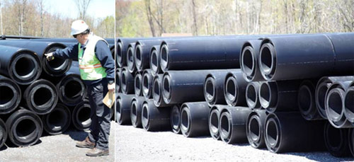 Worker (left) points to the 22-inch pipe that encases the 16-inch pipe.