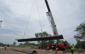 Steel panels are delivered to the lakeshore.