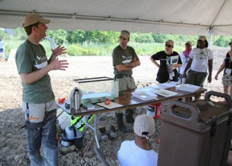 Ryan Davis, Principal Scientist, Anchor QEA, answers questions from volunteers about monitoring of wetland habitats.