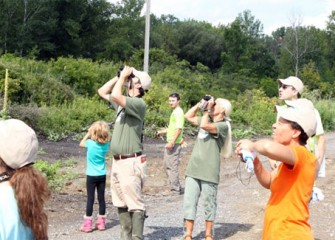 Community members observe bird species including Osprey, Red-tailed Hawk and several varieties of shorebirds during a tour led by Audubon volunteers.