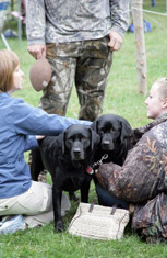 Local dog handlers demonstrate how dogs learn to retrieve water fowl.