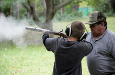 Seventh grader and sportsman-in-training Michael Harris from Solvay learns safe practices under the watchful eye of Ron Rosen, president of Elbridge Rod and Gun Club.