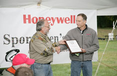Onondaga County Federation of Sportsmen's Clubs President Steve Wowelko presents Honeywell Program Director John McAuliffe with a plaque in appreciation of Honeywell's participation and partnership during the volunteer dinner.
