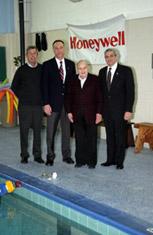 Honeywell Program Director John McAuliffe and Victor and John DeSpirito tour the Solvay-Geddes Community Youth Center pool with Executive Director Leonard Pfeiffer.
