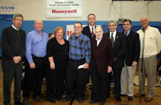 Solvay-Geddes Community Youth Center Executive Director Leonard Pfeiffer, Geddes Supervisor-Elect Emanuele Falcone, Solvay Mayor Kathy Marinelli, Solvay Tigers Athletic Club President Joseph Alcaro, Honeywell Program Director John McAuliffe, Victor DeSpirito, John DeSpirito, Assemblyman William Magnarelli and Geddes Supervisor Robert Czaplicki celebrate Honeywell's and the DeSpirito family's gift.