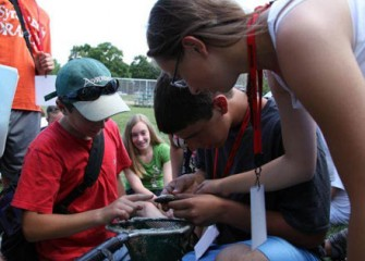 Students at Honeywell Summer Science Week Examine the Various Types of Fish they Caught in Nine Mile Creek at Munro Park.