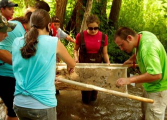 Honeywell Summer Science Week Participants Work Together to Collect Field Samples from Onondaga Creek.