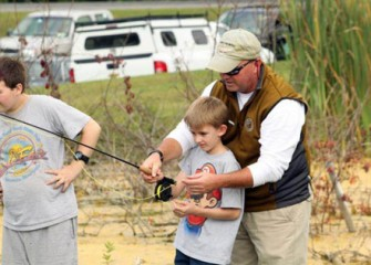 Young Sportsmen Receive Lessons from a Trout Fly Fishing Instructor.