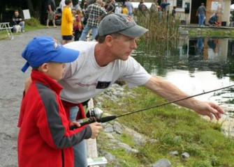 A Fisherman-in-Training Gets a Lesson from His Dad.