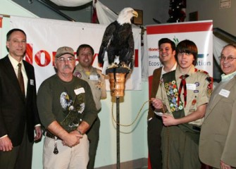 Eagle Scout Candidate Will Hirsh and his Dad Pose with Audubon and Honeywell Representatives and Liberty the Bald Eagle