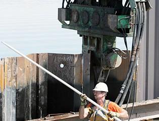 Worker Checks Installation Progress