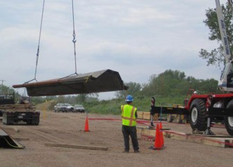 The first steel arrives to the shoreline to begin Phase III of the Barrier Wall.