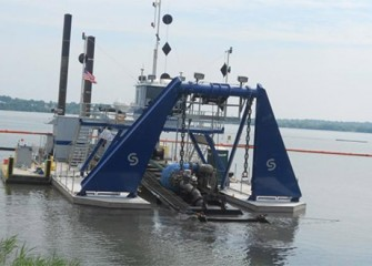 A hydraulic dredge operates in Onondaga Lake. Over the next four years three hydraulic dredges will remove about 2 million cubic yards of material from the lake bottom.