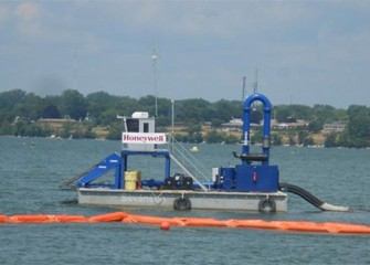A capping barge on Onondaga Lake. The lake bottom cap will cover about 450 acres of the lake. The cap will provide a new habitat layer, prevent erosion, and isolate any remaining contaminants.