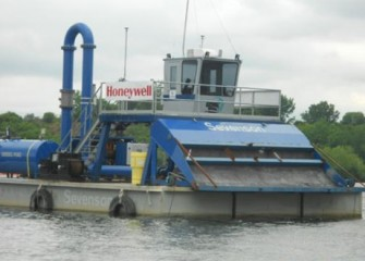 A hydraulic capping barge on Onondaga Lake before operations begin.