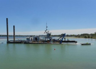 The cutter head on the largest dredge, Marlin, is raised to begin a maintenance check.