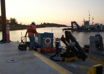 Equipment is loaded onto a support boat at sundown.