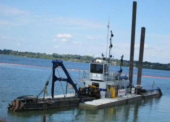 Medium-sized dredge on Onondaga Lake.