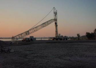 A 600-ton crane on western shoreline to assist with debris removal
