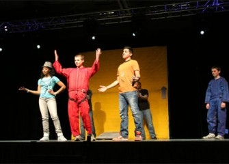 Students participate in exciting and interactive science lessons on stage to demonstrate Newton's laws firsthand.