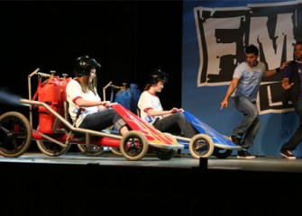 Middle school students race to the finish line in go-carts, learning about Newton's Third Law of Motion.