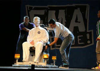 West Genesee Principal Earl Sanderson receives a cream pie in the face to help demonstrate all three of Newton's laws.