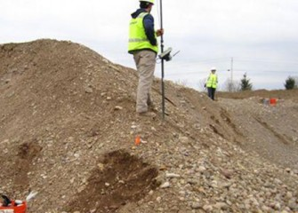 Surveyors use GPS to carefully map the placement of soil