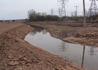 Geddes Brook is temporarily rerouted allowing workers to restore the wetlands in dry conditions