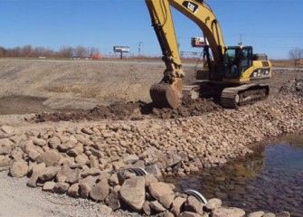 A temporary berm is built to redirect the flow of Geddes Brook