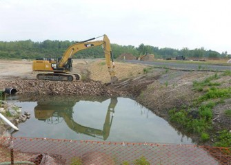 Process begins to remove a berm and allow water into the new Geddes Brook channel