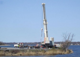 A 600-ton crane will aid in assembly of dredging equipment.