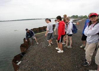 Students Examine the Underground Barrier Wall