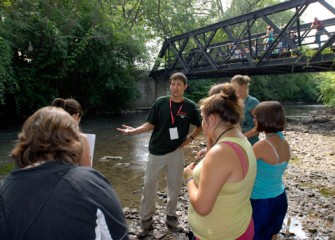A Graduate Student from SUNY-ESF Prepares Students to Explore the Habitat along Onondaga Creek