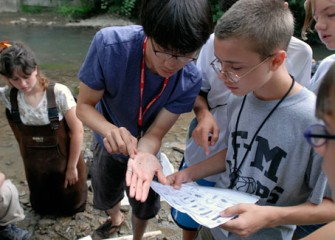 Students Work Together to Identify Samples Pulled from Onondaga Creek during Honeywell Summer Science Week at the MOST