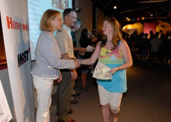 Onondaga County Executive Joanie Mahoney and Honeywell Syracuse Program Director John McAuliffe Congratulate a Student upon Completion of the Honeywell Summer Science Week at the MOST