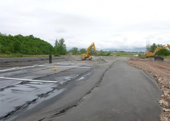 An area is constructed nearby Nine Mile Creek to allow excavated material to dry; a liner is placed beneath the entire area.