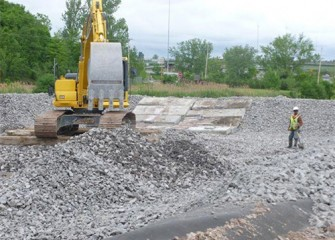 Gravel is placed over the liner to allow water to drain to collection systems.