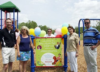 Camillus Resident and Local Mom Leslie Petty (center) Initiated Work on the Community Playground