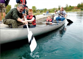 Boy Scouts Master of Troop 116 in Cicero Teaches Young Kids how to Canoe