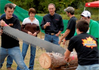 State University of New York College of Environmental Science and Forestry's Woodsmen's Team Demonstrates Cross Cutting a Log