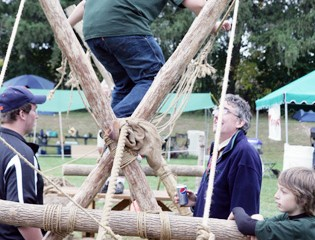 A Young Sportsman Tries out the Boy Scouts' Ropes Course