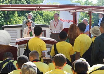 City of Syracuse Mayor Stephanie Miner talks about the importance of studying science, technology, engineering, and math before a Honeywell Summer Science Week at the MOST boat tour of Onondaga Lake. Honeywell Program Director John McAuliffe (right) and Museum of Science and Technology Exhibits Project Manager Peter Plumley (left) listen.