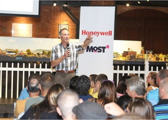 Honeywell Program Director John McAuliffe asks students what they learned during Honeywell Summer Science Week at the MOST