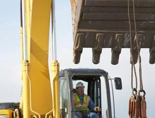 Worker Operates Machinery
