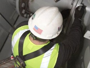 Worker connecting sections of pipe together